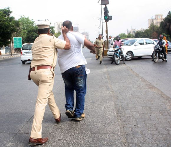 Police arrests a man causing disruption during Thursday's Thane bandh