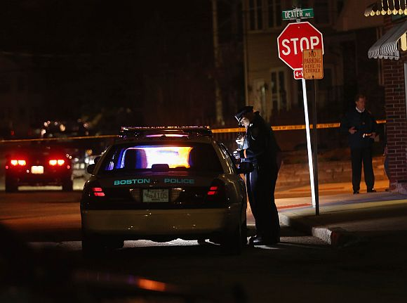 Police investigate along Dexter Avenue in the early morning hours on April 19