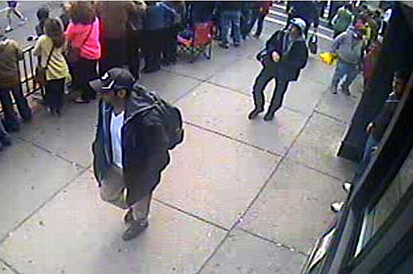 An image released by the FBI of the people they have identified as suspect 1 (L) and suspect 2 (white hat) being sought in connection with the Boston Marathon bombings. The FBI is urging those with information about either of the two men pictured to contact them at 1-800-CALL-FBI or at https://bostonmarathontips.fbi.gov/