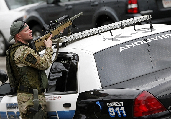 SWAT teams conduct a house to house search as they look for Dzhokar Tsarnaev