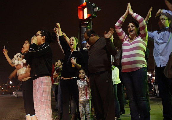 PICS: Jubilant Bostonians celebrate after suspect