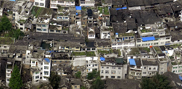 An aerial view shows houses damaged after a strong earthquake in Lushan county, Ya'an, Sichuan province