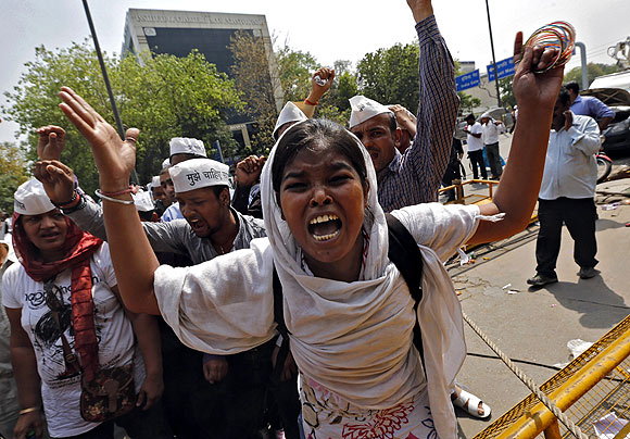 Demonstrators shout slogans during a protest outside police headquarters in New Delhi