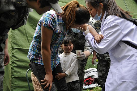 People are treated for injuries after a strong earthquake hit Southwest China's Sichuan Province