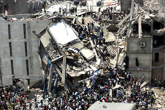 People rescue garment workers trapped under rubble at the Rana Plaza building