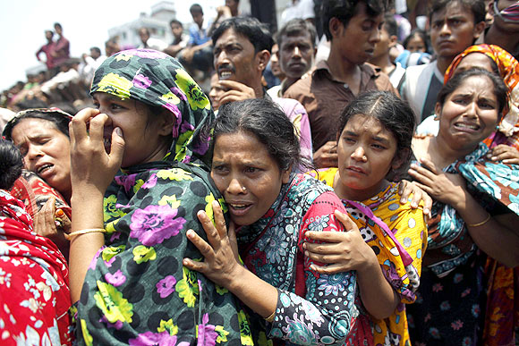People mourn for their relatives, who are trapped inside the rubble of the collapsed Rana Plaza building