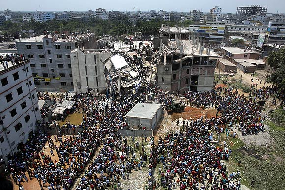 Crowds gather at the collapsed Rana Plaza building
