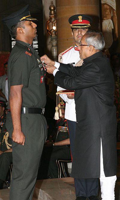 President Pranab Mukherjee presenting the Kirti Chakra to Major Anup Joseph Manjali