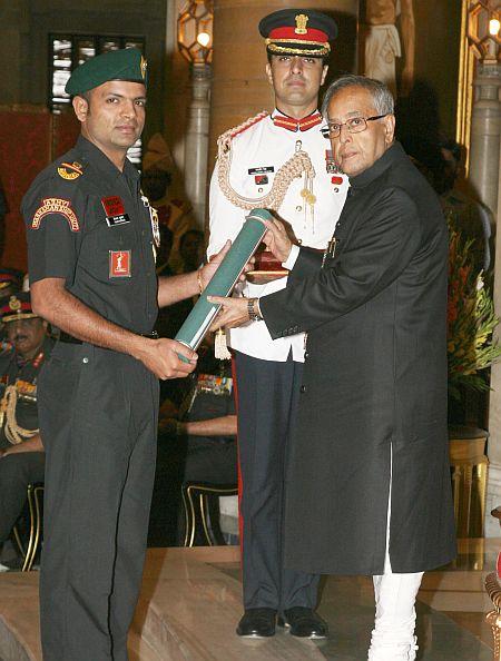 President Pranab Mukherjee presenting the Ati Vishisht Seva Medal to Subedar Major Vijay Kumar