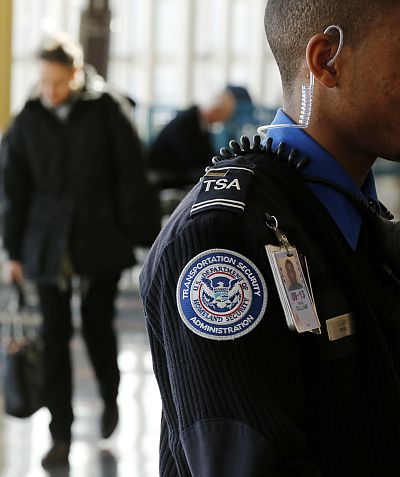 The logo on the sweater of a Transportation Security Agency (TSA) officer is seen at Washington's Reagan National Airport outside Washingto