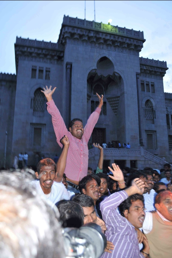 Telangana supporters celebrate after UPA annouced statehood for the region