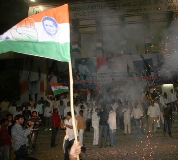 Congress workers burst firecrackers after the division of Andhra Pradesh