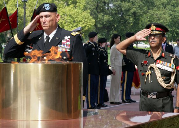 US Army Chief General Raymond Odierno saluting at the Amar Jawan Jyoti in New Delhi