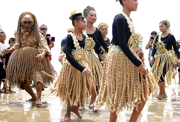 Members of Malaysia's indigenous Mah Meri tribe perform prayers on the seabed of the Malacca Straits at low tide.