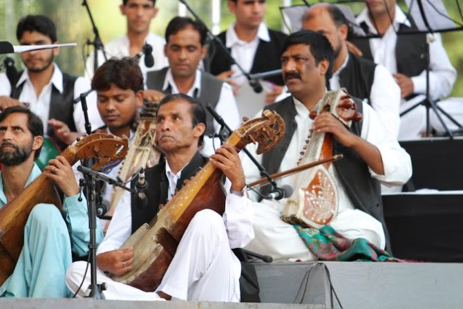 Kashmiri musicians performing with Zubin Mehta's assemblage at Srinagar's Shalimar Bagh