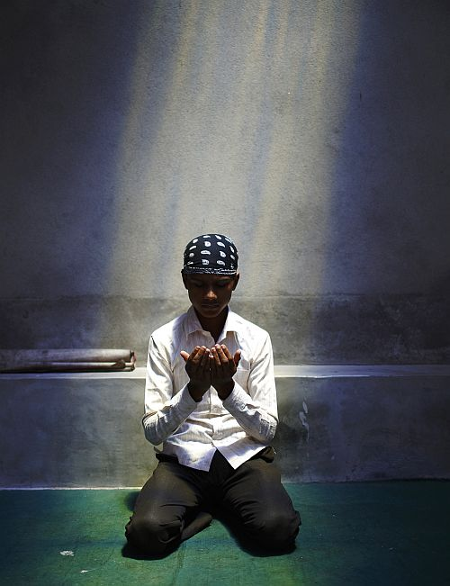 A Nepalese Muslim boy offers Friday prayers in Kathmandu