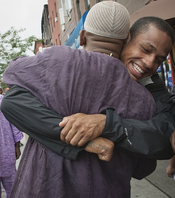 Hugs and prayers mark Eid around the world