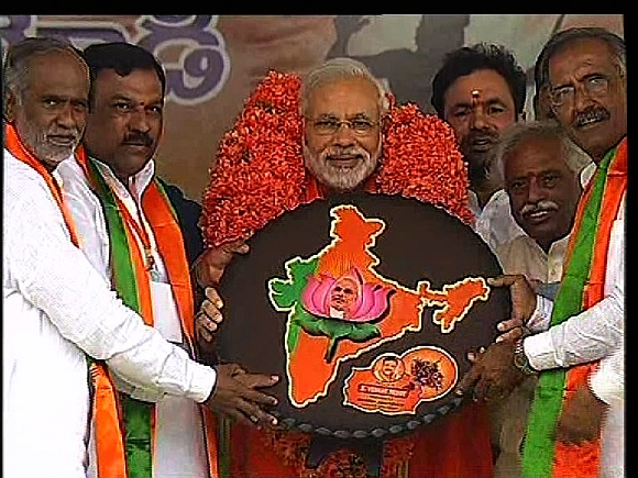 Gujarat Chief Minister Narendra Modi is greeted by the Andhra BJP unit