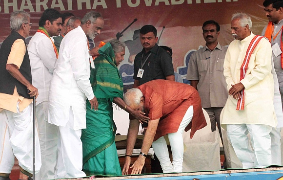 Modi seeks blessings of an 85-year-old woman who had wished to be at the rally