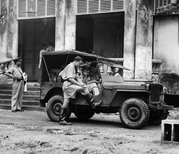 Circa 1940: Soldiers manning a wireless van during Mahatma Gandhi's 73 hour fast, receive news about the riots from police headquarters at Lalbazar.