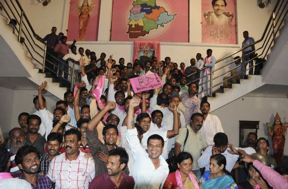 TRS supporters cheer as they celebrate after the announcement of separate Telangana at their headquarters in Hyderabad