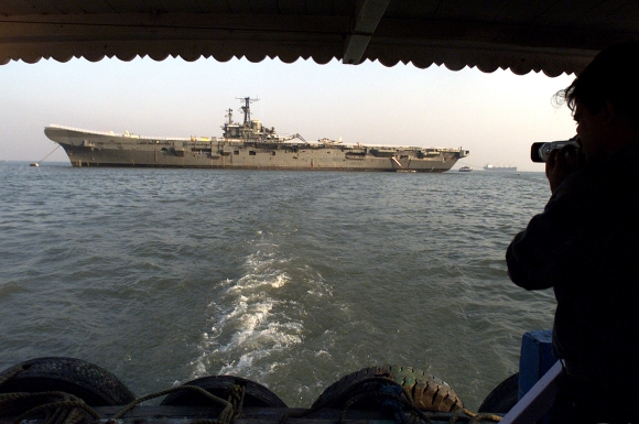 A photographer shoots pictures of the Indian museum ship the Vikrant off the Mumbai coast