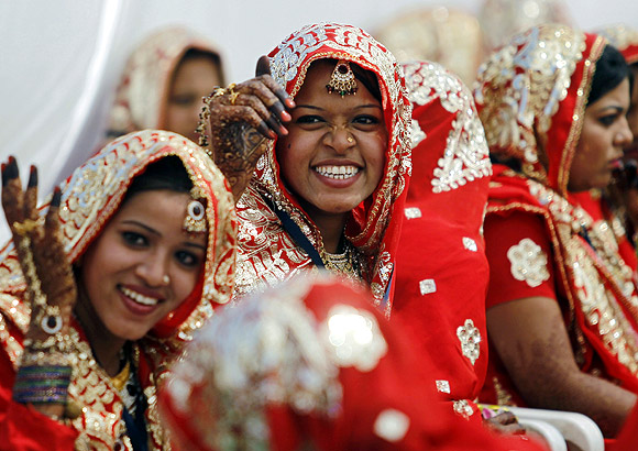 Muslim brides at a mass marriage ceremony in Ahmedabad.