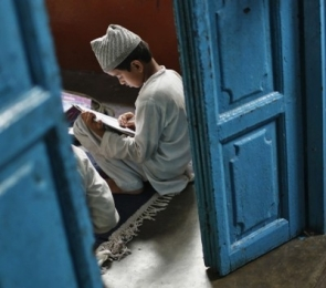 A student studying in a madrassa