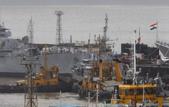 Ships and a submarine belonging to the Indian Navy are seen docked at the naval dockyard in Mumbai on Wednesday