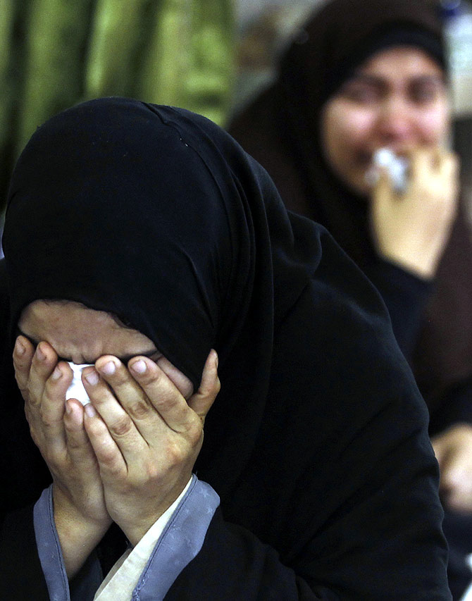 Relatives of dead members of the Muslim Brotherhood and supporters of deposed Egyptian President Mohamed Mursi react and cry at El Eyman mosque