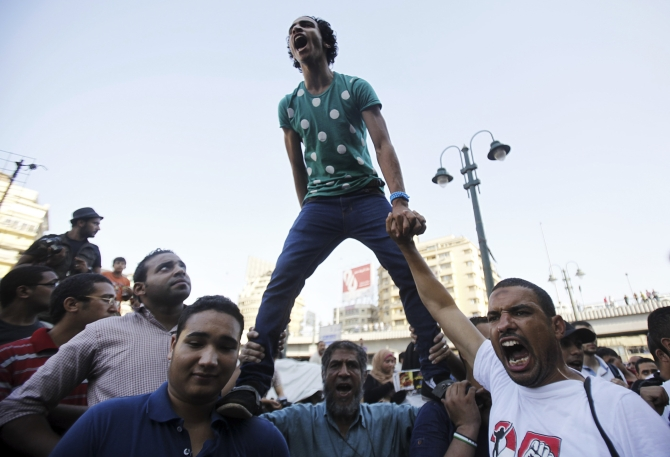 Supporters of the Muslim Brotherhood and Morsi shout slogans in Cairo