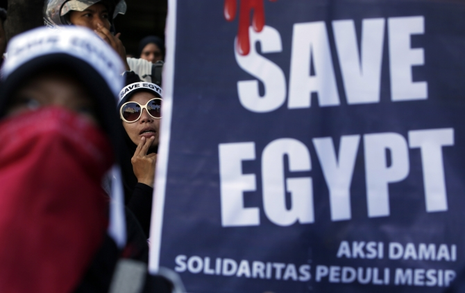 Indonesian Muslim women take part in a protest against the Egyptian government's crackdown on supporters of Morsi