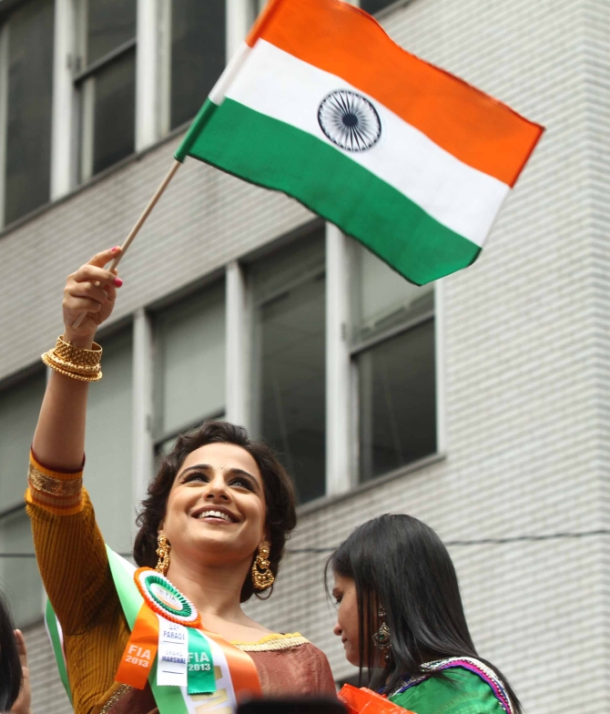 Bollywood actor Vidya Balan waves the tricolour at the India Day Parade in New York