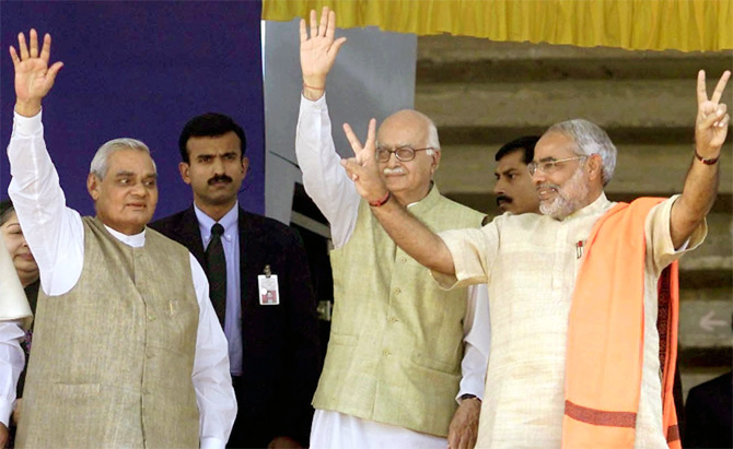 BJP leaders Atal Bihari Vajpayee and L K Advani with Gujarat Chief Minister Narendra Modi at a political rally