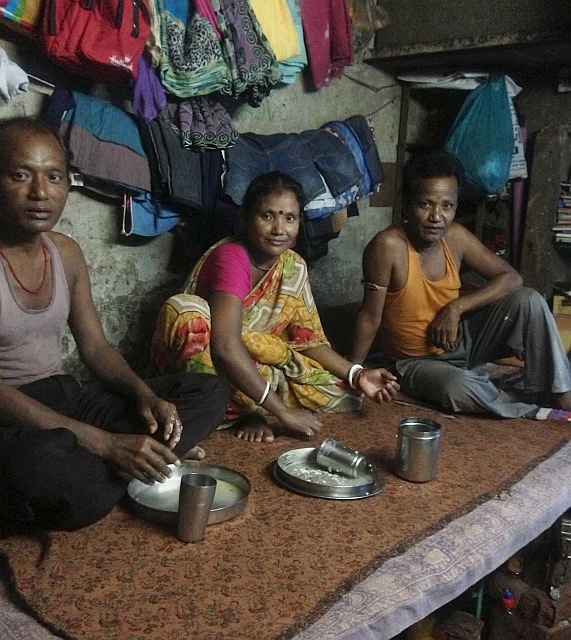 Deepali sits down for a meal with her husband (right)