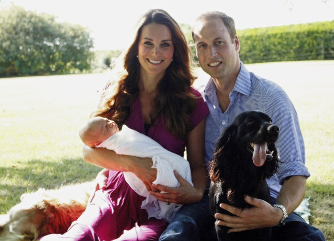 In this handout image provided by Kensington Palace, Catherine, Duchess of Cambridge and Prince William, Duke of Cambridge pose for a photograph with their son, Prince George Alexander Louis of Cambridge, surrounded by Lupo, the couple's cocker spaniel, and Tilly the retriever (a Middleton family pet) in the garden of the Middleton family home in August 2013 in Bucklebury, Berkshire
