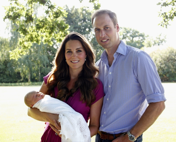 In this handout image provided by Kensington Palace, Kate and Prince William pose for a photograph with their son Prince George in the garden of the Middleton family home in August 2013 in Bucklebury, Berkshire