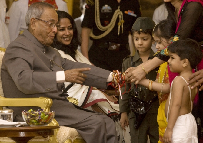 School children tie 'rakhi' to Pranad Mukherjee at Rashtrapati Bhavan