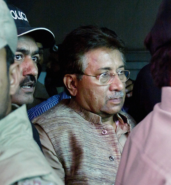 Pakistan's former president and head of the All Pakistan Muslim League political party Pervez Musharraf is escorted by security officials as he leaves an anti-terrorism court in Islamabad