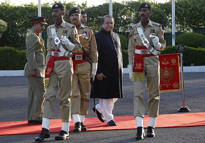 Pakistan's Prime Minister Nawaz Sharif inspects the guard of honor during a ceremony as he arrives at the prime minister's residence after being sworn-in, in Islamabad