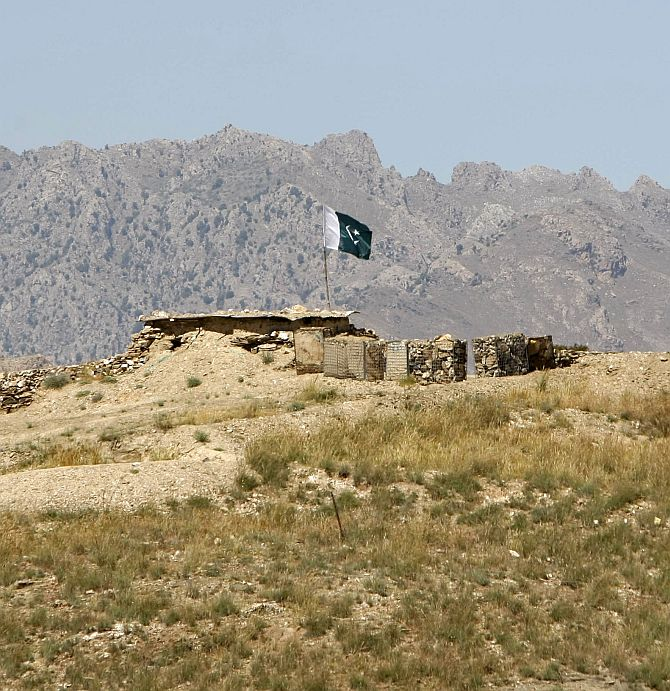 A Pakistani flag flies on top of a check post