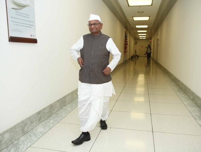 Hazare walks in the empty corridors of Capitol Hill