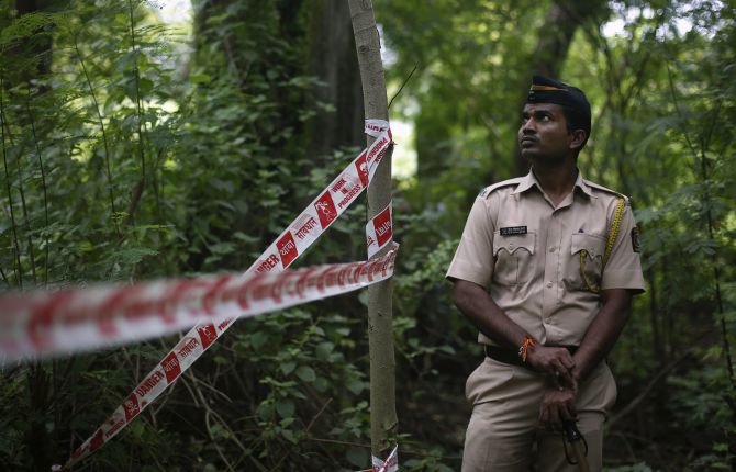 A policeman stands guard near the crime scene in Mumbai