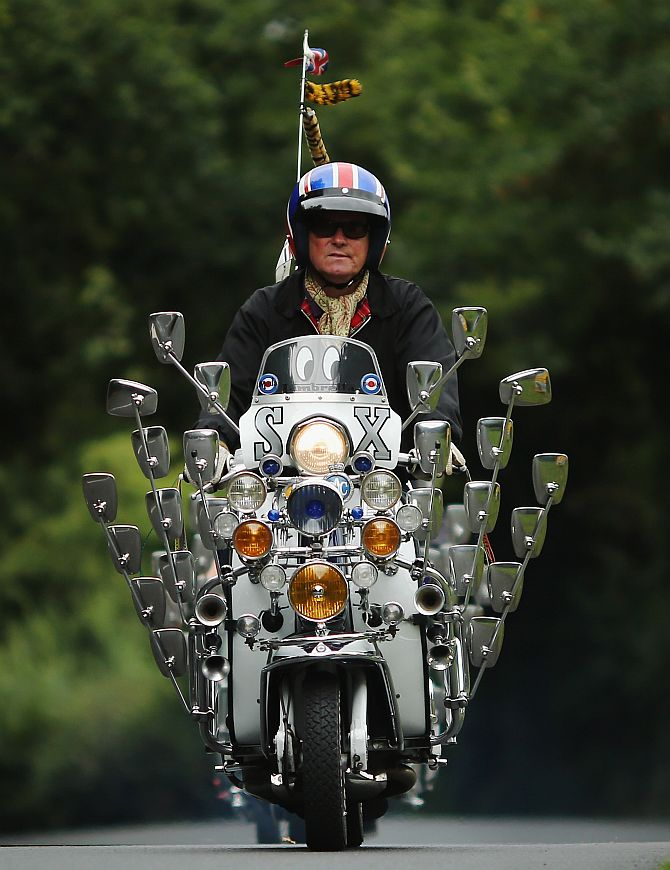 A scooter rider makes his way along a country lane during the the Isle of Wight International Scooter Rally