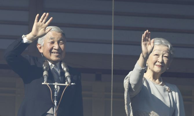 Japan's Emperor Akihito and Empress Michiko wave to well-wishers during a public appearance in Tokyo
