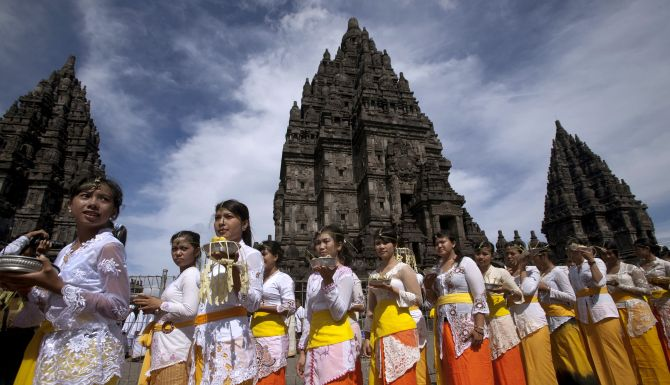 Balinese Hindu worshipers walk during the Tawur Agung ritual ahead of 'Nyepi', Bali's Day of Silence and the Hindu New Year, at Prambanan temple in Yogyakarta