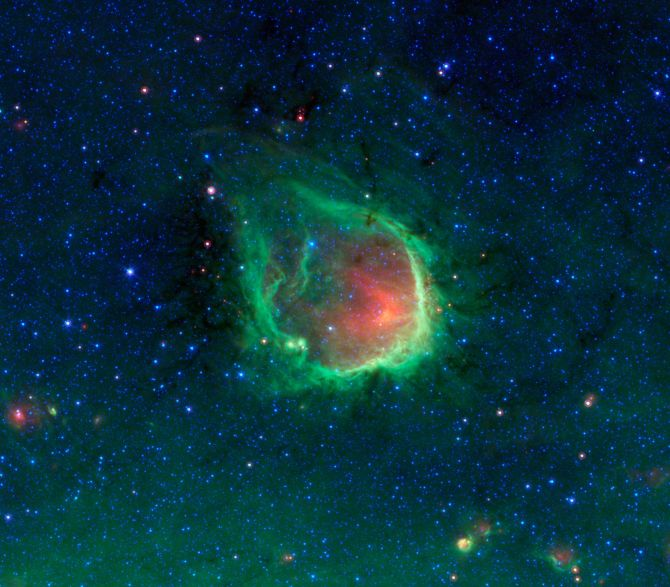 This glowing emerald nebula seen by NASA's Spitzer Space Telescope