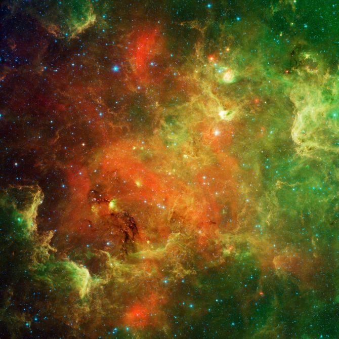 The swirling landscape of stars known as the North American nebula is shown in this image observed by Spitzer telescope