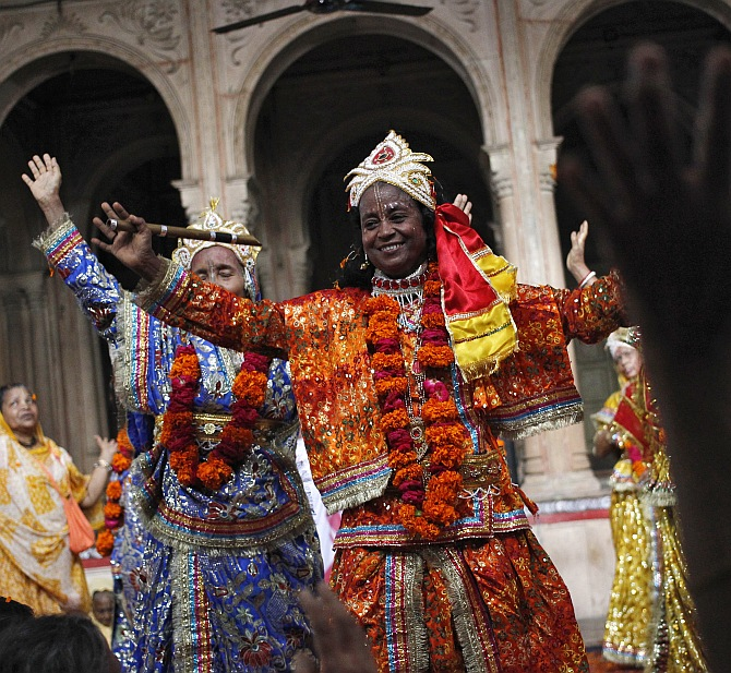 A widow dressed as Krishna's consort, Radha, dances during celebrations to mark Janmashtami at the Meera Sahavagini ashram in Vrindavan in Uttar Pradesh