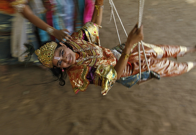A student dressed as Krishna takes part in the celebrations to mark Janmashtami at a college in Chennai.